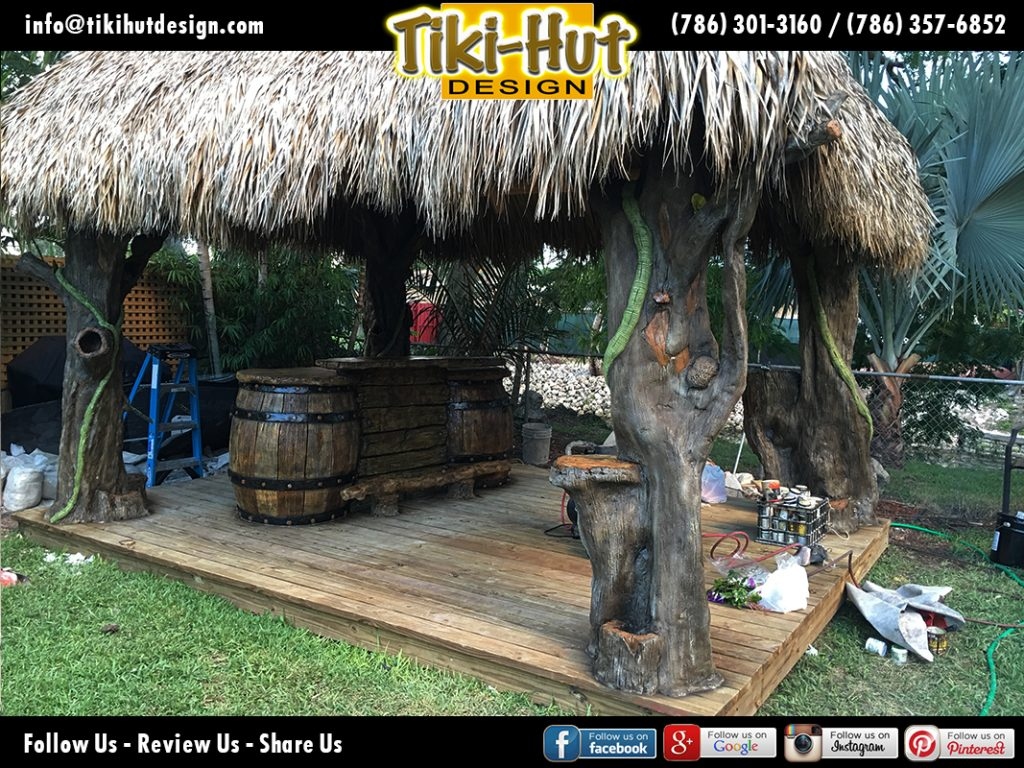 Custom-tiki-hut-desing-with-cement-barrel-tiki-bar