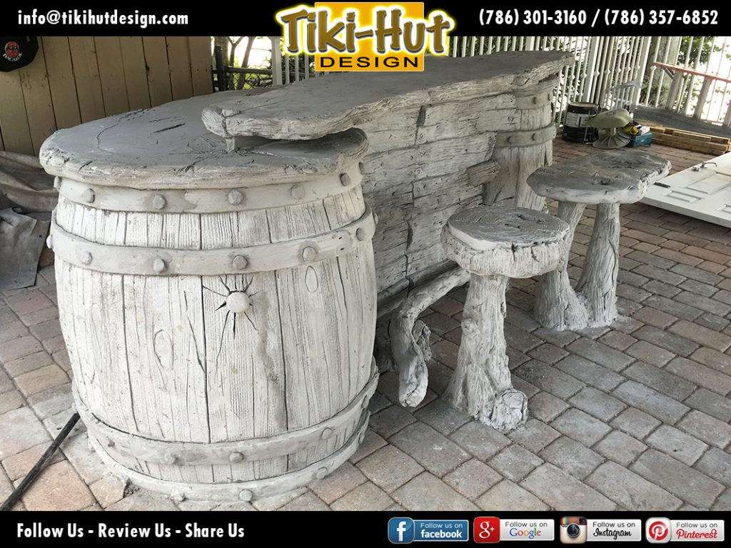 Custom-tiki-hut-desing-with-cement-barrel-tiki-bar-under-construction