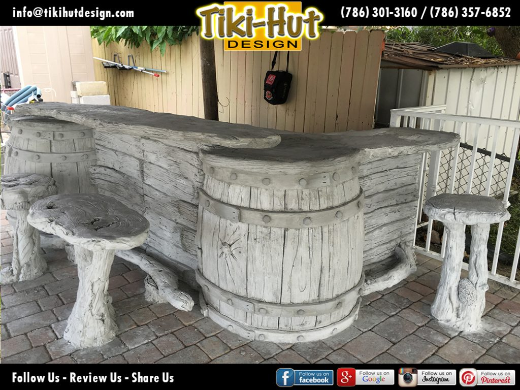 Custom-tiki-hut-desing-with-cement-barrel-tiki-bar-under-construction-detail
