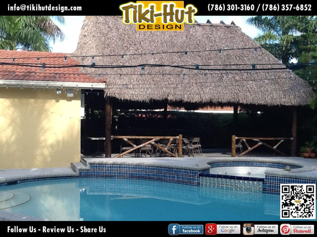 Tiki-Hut-Mounted-on-roof-of-a-house-with-pool-view-by-Tiki-Hut-Design-of-Miami